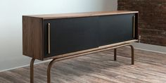 dark wood and black credenza with sliding front