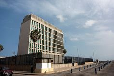 JULY 18 2015 U.S. And Cuba Set To Formally Re-Establish Diplomatic Relations || A security guard stands outside the U.S. Interests Section building that has served as the American outpost in Havana under the auspices of the Swiss government, in Havana, Cuba on Wednesday, July 1, 2015. ... - Noah Friedman-Rudovsky/Bloomberg