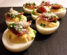 Deviled eggs with pickled jalapenos, bacon, and sriracha