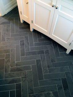 Beautiful black slate tile stone flooring in bathroom. Laid in a herringbone style pattern || Express Flooring | Phoenix, Arizona