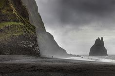 Vik Beach in Iceland. Vik is the southernmost village in Iceland and is also the wettest place in the country. A unique feature of the beaches in Vik are the basalt columns rising out from the sea, which are often rough due to the high winds in the North Atlantic.