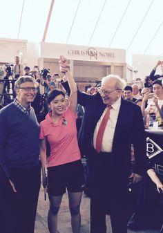 Warren Buffett and Bill Gates play ping pong with Ariel Hsing at Borsheim's in Omaha, Nebraska at the Berkshire Hathaway annual shareholders meeting 2015.