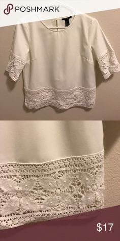 White cropped blouse with Lacey detail. Super cute cropped blouse with lace detail. Worn once. Looks cute with skirts and high waisted bottoms! Forever 21 Tops Blouses