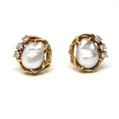 A pair of 18k yellow gold earrings set with baroque pearls and approximately 0.40ctw of G/VS diamonds. Crafted by Arthur King, the earrings measure 18mm x 17mm and weigh 14.8 grams.