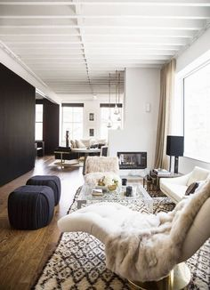 HOMES ANDSPACES - a house in the hills ~ I love the neutral colors, patterned rugs and cozy furs