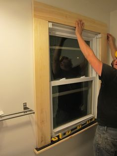 Installing the window trim.