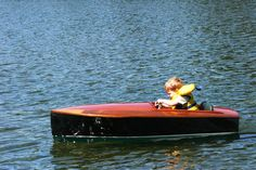 Remote controlled electric baby boat. This beats those power wheels cars any day!