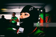 Danica Patrick, driver of the #10 GoDaddy Chevrolet, stands in the garage area during practice for the NASCAR Sprint Cup Series Ford EcoBoost 400 at Homestead-Miami Speedway on November 21, 2015 in Homestead, Florida.