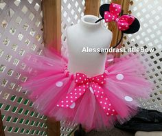 Pink and fuschia minnie mouse tutu. Very fluffy and soft made with high quality tulle. Adorned with her classic polka dots and a bow. Will come with a complimentary ears headband either on elastic ba