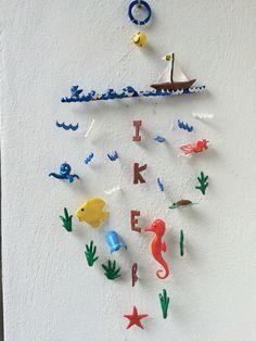 Movil infantil, significado de Iker: portador de buenas noticias. Todo realizado artesanalmente con arcilla polimerica. Diseñado y creado por Stephanie Henke para Isainar Creaciones.
