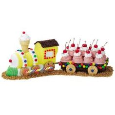 train(This gave me a decorating idea using a toy train and cup cakes for Baby Shower)