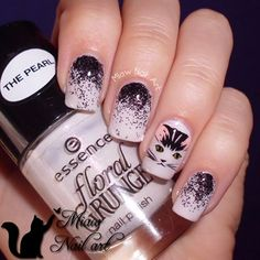 When it comes to nail art, the possibilities are endless. Use glitter, acrylic paint, and nail stamps to get this quirky cat-inspired mani. See the step-by-step tutorial for inspiration.