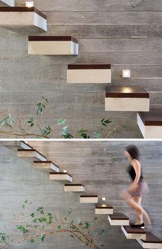 18 Exemplos de Stair detalhes para inspirá-lo // Estas escadas de concreto flutuantes são cobertas com madeira.