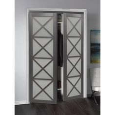 ReliaBilt Reliabilt Gray Flush MDF Pivot Door Hardware Included (Common: x Actual: x at Lowe's. The Model features high quality European designed and inspired pivot doors, featuring tempered frosted glass up to four times stronger than regular Frosted Glass Design, Pivot Doors, Bifold Doors, Home Improvement, Glass Barn Doors, Door Design, Reliabilt, Wood Glass, Doors Interior