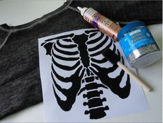 I want to be a skeleton for halloween just because of this DIY glitter ribcage Skeleton shirt!