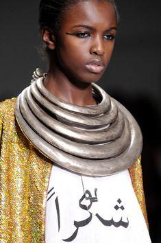 Model wearing Miao (China) neckrings | Ashish Spring 2014 - Details