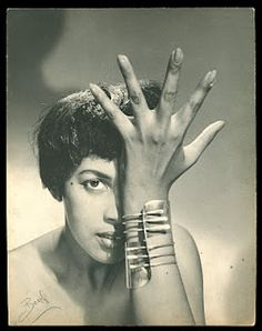 """Model wearing Cuban-born, Brooklyn-reared jeweler Art Smith's """"Modern Cuff"""" bracelet, ca 1948. From Brooklyn Museum website:   """"Trained at Cooper Union, Art Smith, an African American, opened his first shop on Cornelia Street in Greenwich Village in 1946. One of the leading modernist jewelers of the mid-twentieth century, Smith was also an active supporter of black and gay civil rights, an avid jazz enthusiast, and a supporter of early black modern dance groups."""""""