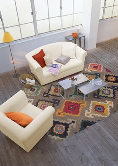 Modern Gray Multi-Color Ikat Style Rug The Kaleidoscope collection showcases bright, vibrant colors of sunshine yellow, tangerine, hot pink and bright poppy whi