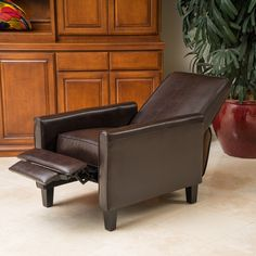Relax in style with this recliner club chair featuring a solid frame and sturdy feet for added stability and strength. This comfortable reclining chair is great for small spaces and functions as a great place to take a nap or read a book.