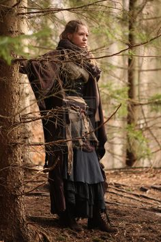 """The costume consists of different skirts(layer on layer) a shirt, different kinds of belts - often with garnish and stuff like that dangling from them, and a corset to create some feminine shape to the costume. In the winter time, as on the picture, I also add some kind of a cloak/cape or a hood, to keep myself warm."" - From the wood she comes... by EpicTeaWater"