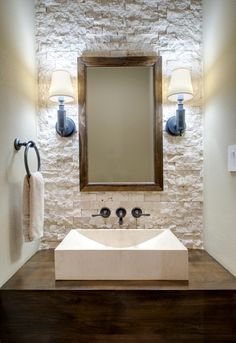 I love the stone against the dark wood counter and the modern raised sink - rustic luxury! would look great with the barn board wood tile floor with grey, tan and white