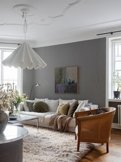I love how cozy and characterful this Swedish home is. The wooden floor combined with the grey walls (lighter in the bedroom and darker in the living room) and the different tints of wood in the vintage furniture pieces really … Continue reading → Grey Tone Living Room Decor, Living Room Modern, Living Room Interior, Living Room Designs, Dark Grey Walls Living Room, Interior Office, Interior Design, Retro Home Decor, Vintage Furniture