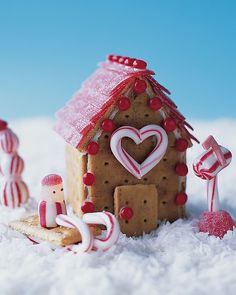 "Peppermint Place Cookie Cottage - cute graham cracker ""gingerbread"" houses on Martha Stewart; there are pics of some other cute ideas. Use chocolate graham crackers!"