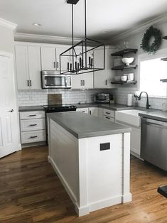 There are several ways you can make concrete countertops and several recipes for the concrete out there. My husband did a lot of research and& The post How to Make DIY Concrete Countertops appeared first on Ajwa Homes. Kitchen Redo, New Kitchen, Kitchen Remodel, Kitchen Ideas, Kitchen Makeovers, Kitchen Tops, Design Kitchen, Kitchen Colors, Kitchen Hacks