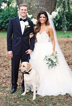 Bride and Groom with Yellow Lab in a Bow-Tie Ways to Include Your Pet in the Wedding | Brides.com