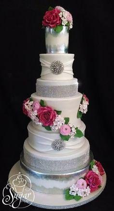 https://flic.kr/p/wvEm25   rhinestone wedding cake   Real rhinestones and lots of sugar flowers adorn this 7-tier showpiece.