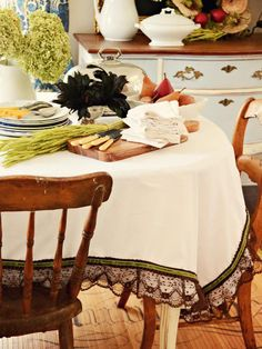 ~ Sophisticated Embellished Fall Tablecloth....    A plain white tablecloth is given a chic facelift with some lace, pleated trim and ribbon in warm fall colors. This low-sew project is great for seamstresses of all skill levels.
