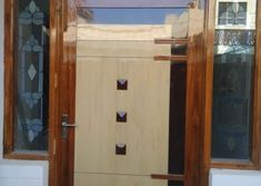 Homemade door design is or your luxury houses, you can choose fancy entrance doors prepared with glass grills or different framing. Door Design Photos, Home Door Design, Glass Panel Door, Glass Panels, Room Doors, Entrance Doors, Yui, Wooden Doors, Teak Wood