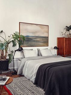 COlours. Colours. Colours. High credenza right next to bed. plant and pot. Cx Joanna Laven's Stunning Stockholm Apartment.