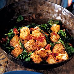 Sweet scallops are given a Cajun-flavored crust, then tossed with balsamic-vinegar-dressed spinach and crisp-cooked bacon in no time flat for a dish that's both homey and elegant.