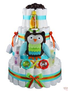 """Our Cutey Hootey Owl Diaper Cake is the smart choice for your next baby shower!  The new little one will love reaching for the owl stroller toy and shaking the barbell rattle.  Rest assured, the recipient of this diaper cake will always remember """"who"""" gave them this beautiful gift!  http://www.rattlecake.com/diaper-cakes/cutey-hootey-owl-diaper-cake-4-tier.html  $115"""