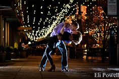 Cool night engagement photo at Larimer Square in Denver