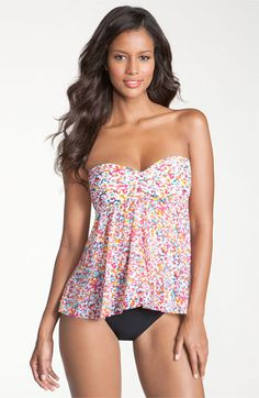 A riot of tiny blossoms blooms across fluid, flowy tankini top designed with a center twist that shapes the sweetheart bust