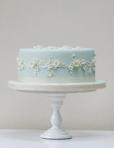Light Baby Blue Cake with Delicate White Detail & Tiny Little White Flowers with hints of Pastel Yellow ~ So Pretty