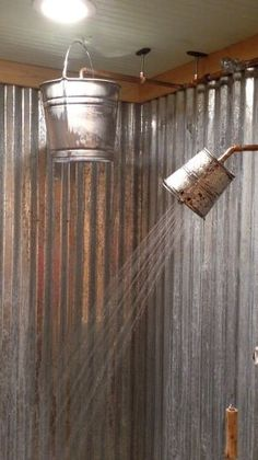 The small bucket is a shower head, the large one i. The small bucket is a shower head, the large one i.