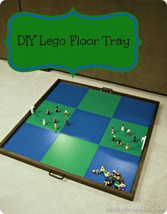 I got these from Lowe's – they were inexpensive and simple but I wanted the handle to be really easy to grab. We laid out the Lego mats and immediately the kiddo was playing: