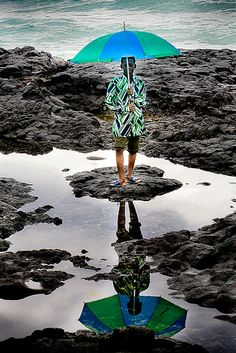 Amazing colours, love how the umbrella matches the shirt! Somewhere in Moroni, Comoros apparently?