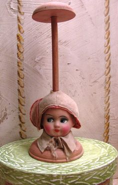 Antique Paper Mache Doll Head Hat Stand. $250.00, via Etsy.