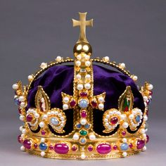 This is a reproduction of the crown worn by the infamous Henry VIII, the powerful plus-sized king with many wives.  The original was made either for Henry VIII or his father Henry VII and was worn by subsequent Tudor and Stuart monarchs up until it was broken apart & melted down at the Tower of London in 1649 under the orders of Oliver Cromwell (when the monarchy was abolished and replaced by the Protectorate).   The original crown was made of solid gold and inset with various rubies...