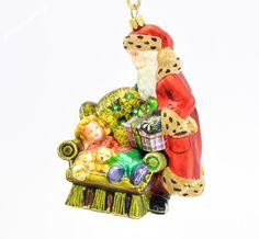 Mikołaj przy fotelu - Polskie bombki ręcznie malowane - sklep z ozdobami choinkowymi Komozja Family
