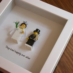 Art frame feature two LEGO® minifigures, Bride and Groom with the a quote: 'They lived happily ever after beneath. Its the perfect gift for