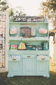 dessert table on a vintage cupboard. Love the idea of buying pieces for the wedding that we can also use in our house!