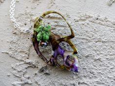 Sliced green and purple shell pendant with gemstone by TwoHarts