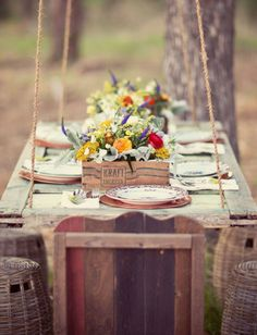 Suspend an oversized door from a tree using sturdy rope to create a picture-perfect outdoor picnic table. See more at Green Wedding Shoes.