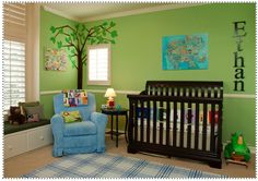 I really like the green wall contrasted with the dark wood crib