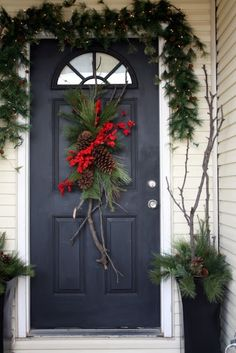 38 Stunning Christmas Front Door Décor Ideas   DigsDigs love the branches go all the way down the page to see your choice
